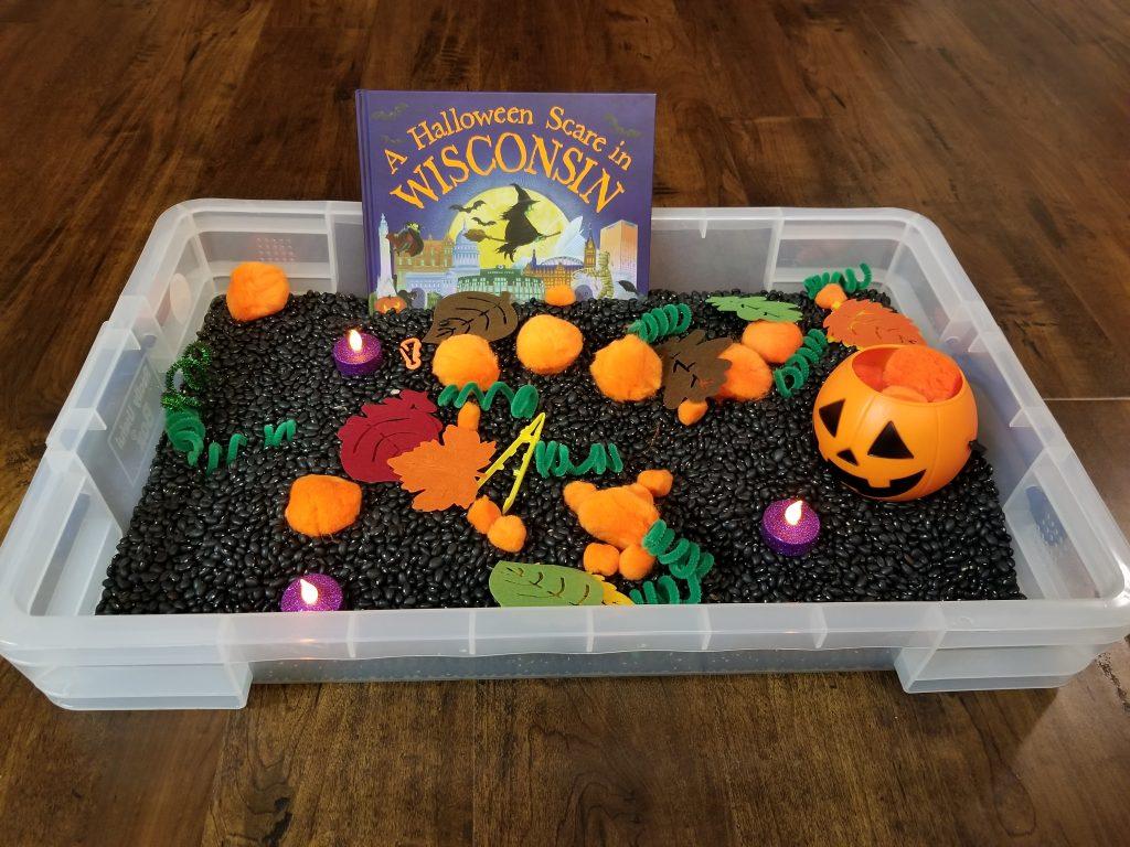 Pumpkin sensory bin with lights