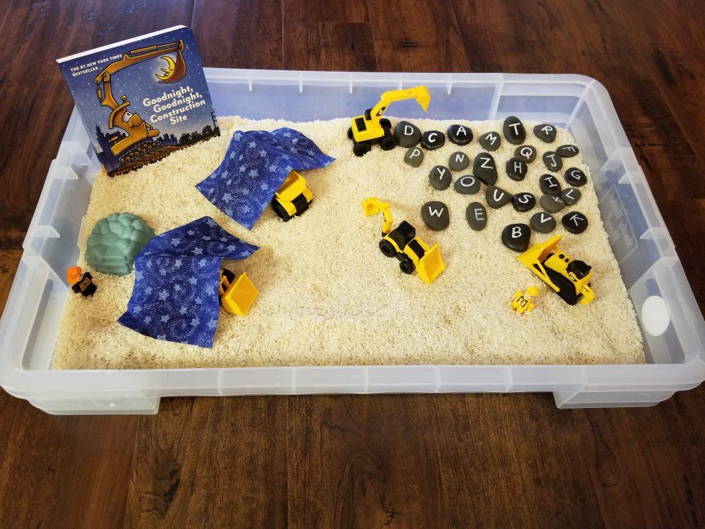 Construction Truck Sensory Bin with Rocks 1